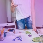 woman-artist-taking-photos-of-her-drawings-using-PAF3XZP